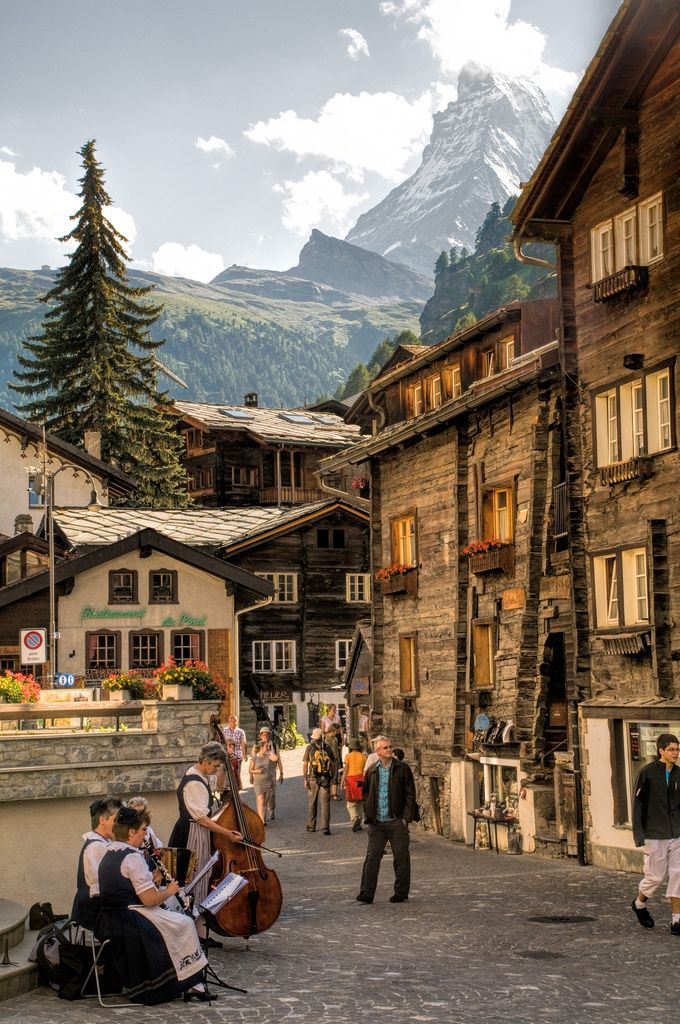 Locals playing their instruments with The Matterhorn in the background ~ Zermatt, Switzerland