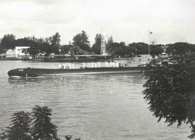 K  XV arriving in Soerabaja (Dutch East Indies), 1940.  Note the dredge in the background. (Photo: © Collection Aart Hopman) .