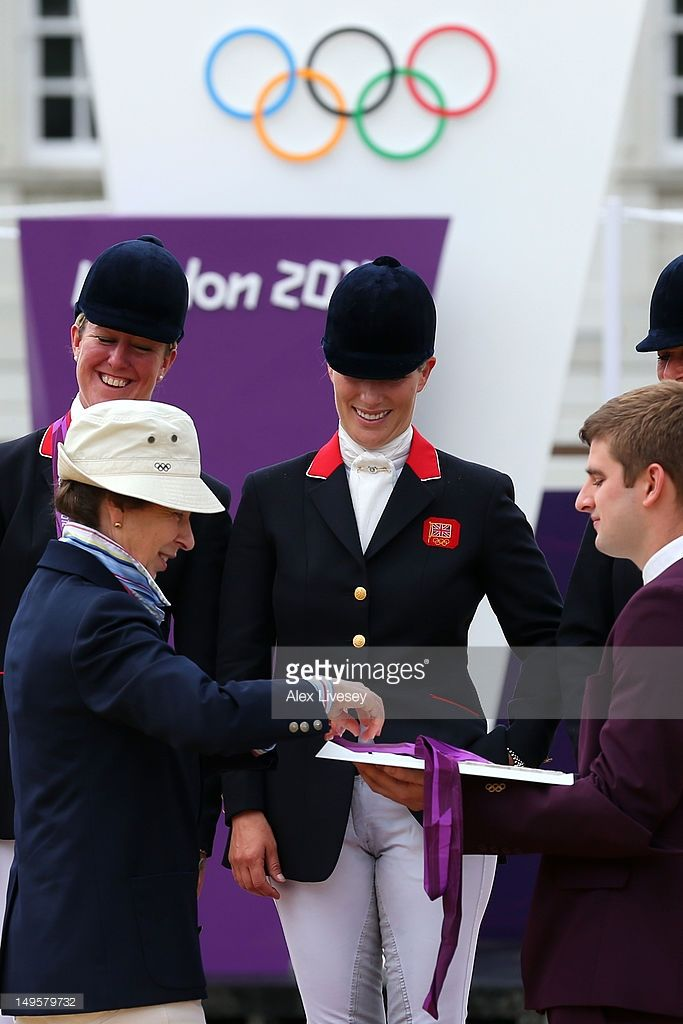 Zara Phillips is presented a silver medal by her mother, Princess Anne, Princess Royal after the Eventing Team Jumping Final Equestrian event on Day 4 of the London 2012 Olympic Games at Greenwich Park on July 31, 2012 in London, England.  (Photo by Alex Livesey/Getty Images)