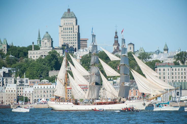 Around 50 tall ships sail out of harbor during a parade in Quebec City, Canada last Monday. The Quebec City and Levis rallying point is a stop for the ships on a transatlantic race of 7,000 nautical miles which takes place over the course of five months.