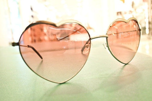 Heart shaped glasses - just quirky enough to be cute.  I'd wear 'em.