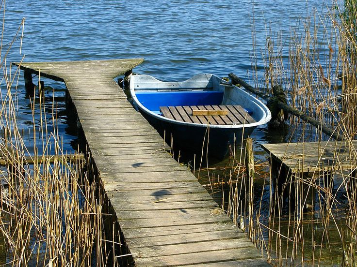 Wooden jetty and old boat.