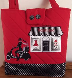 Speed along with the latest fashions with the charming Vespa Shopping Girl Tote from Enchanting Designs.