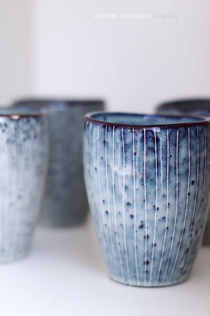 Love this speckled blue pottery glaze // imagine all the things you could do with these lovely cups/glasses/vases, whatever you want them to be