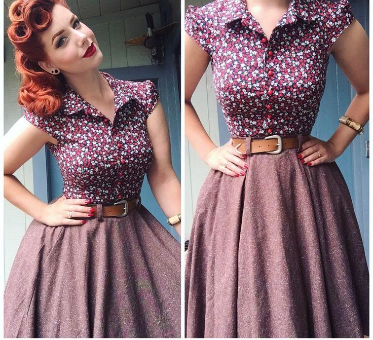 Raspberrily smiling pale-skinned copperhead in mauve polkadot A-line dress