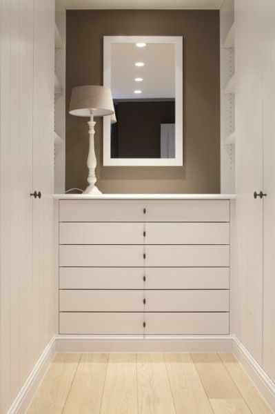 contemporary country walk in wardrobe with white against taupe - by Bieke Vanhoutte