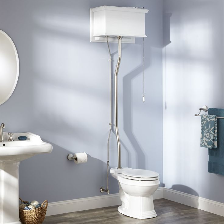 """High Tank Pull Chain Water Closet with Elongated Victorian Bowl in White,   Water closet measures a maximum of 86"""" high.   Solid brass angle stop included. Includes tank, supply line, angle stop, bowl, toilet seat, Fluidmaster control valve."""