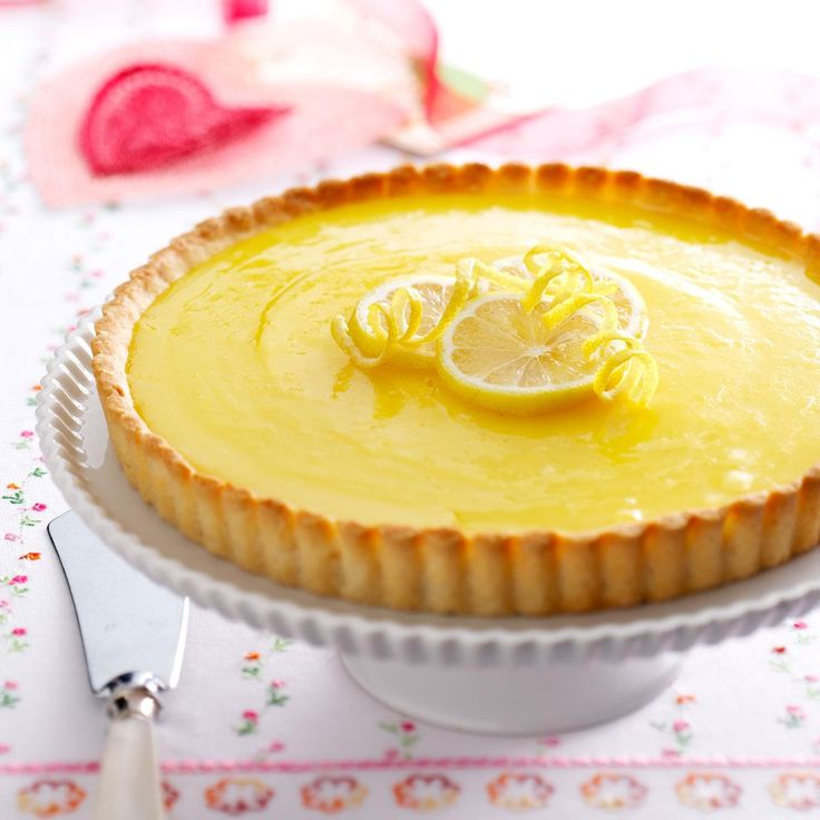 Lemon Tart with Almond Crust Recipe -Our state produces an abundance of lemons, and everyone is always looking for new ways to use them. This beautiful tart is my delicious solution to the excess-lemon problem! —Lois Kinneberg, Phoenix, Arizona
