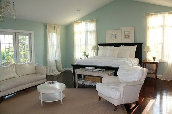Soft and serene with Palladian Blue walls, creams and warming it up with dark wood.