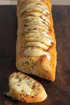 Cheesy Garlic Bread – The secret to the best-ever garlic bread recipe? Just spread slices of French bread with a butter mixture and add slices of cheese before baking!: