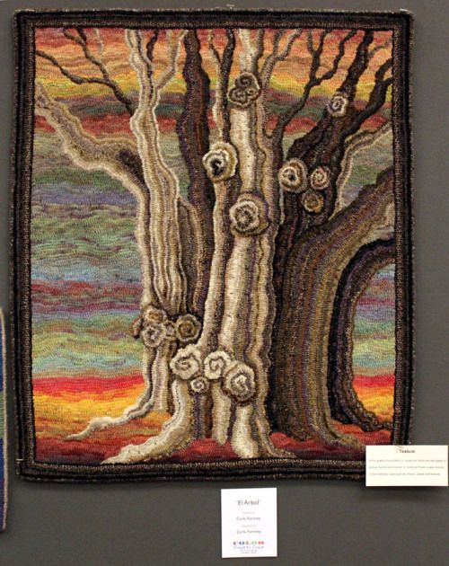 This amazing ancient tree, designed & hooked by Carla Fortney called EL ARBOL. Love all the gnarly knots & the way she achieved the wonderful bark! Her background is just electrifying & a perfect choice of colors that added drama to this magnificent tree without competing for attention! Just stunning!