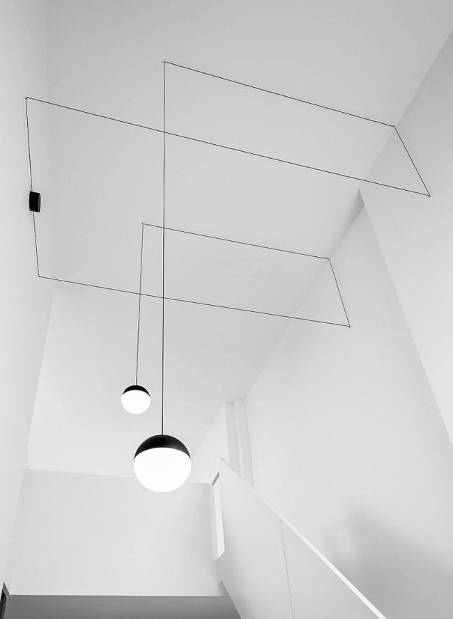 string lights (sphere head) by Michael Anastassiades for FLOS