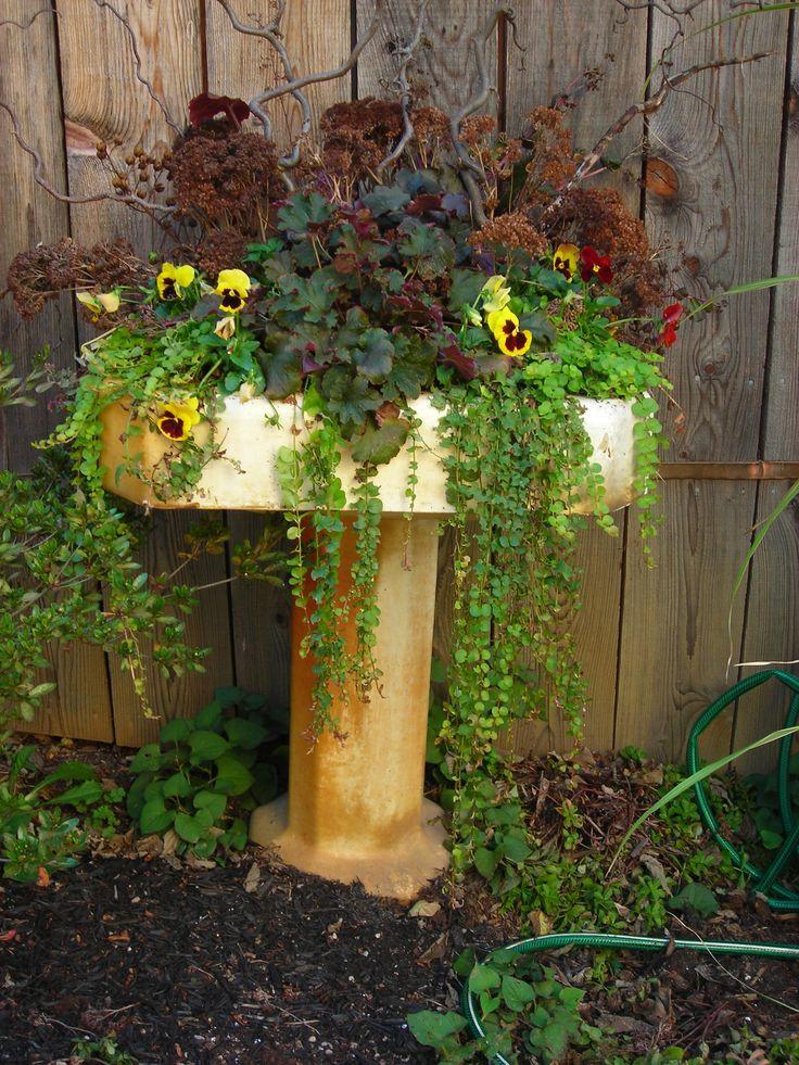 17 best images about unique nostalgic planter ideas on - Unusual planters for outdoors ...