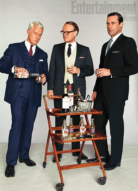 Mad Men Roger Sterling, Lane Pryce & Don Draper belly up to the bar cart. Read why a 3 shelf trolley may work better for them at http://homebars.barinacraft.com/post/31279406196/mad-man-don-drapers-bar-cart