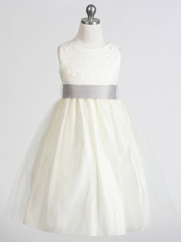 "Now that we've put away those sleigh bells, it's time to ring in those wedding bells! Our customers are loving this ivory jacquard and tulle beauty for their flower girls. Choose from 14 sash colors.  ""I ordered this dress for my 4 daughters to wear at our wedding, it fitted perfectly and looked stunning on them with the lilac sash. Couldn't be happier!!!"" ~Stephanie"