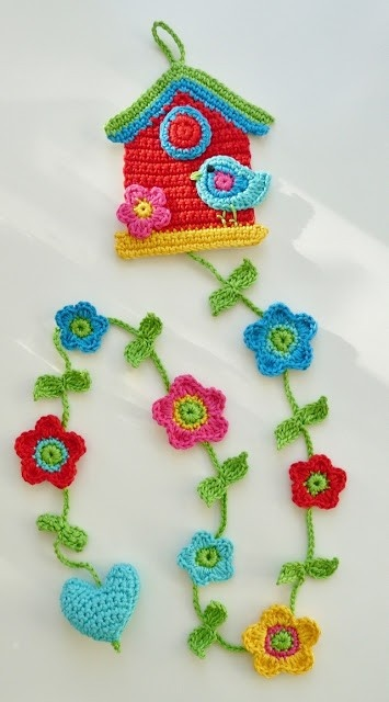 crocheted house, birds, flowers