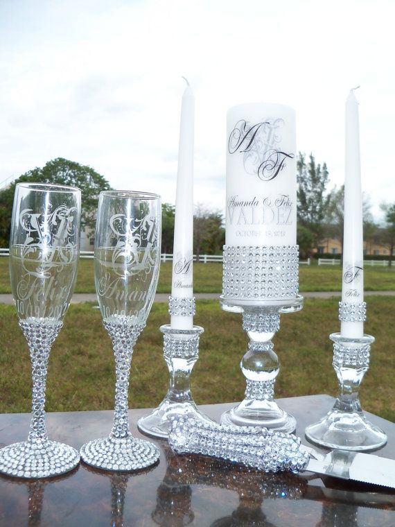 Lots of Bling .....Unity candle,  Holders, Flutes and Cake Server.......Add a memorial candle set. $157.00, via Etsy.