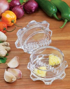 Garlic Twist - the best garlic/ginger/chili crushing tool I've come across, and I've tried lots! For only one clove, I just use a garlic press but this is perfect for larger garlic jobs and definitely for ginger.
