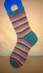 I created this pattern while knitting a(nother) pair of plain vanilla socks in self-striping yarn. I wanted something a little different but equally mindless, and this technique fit the bill.