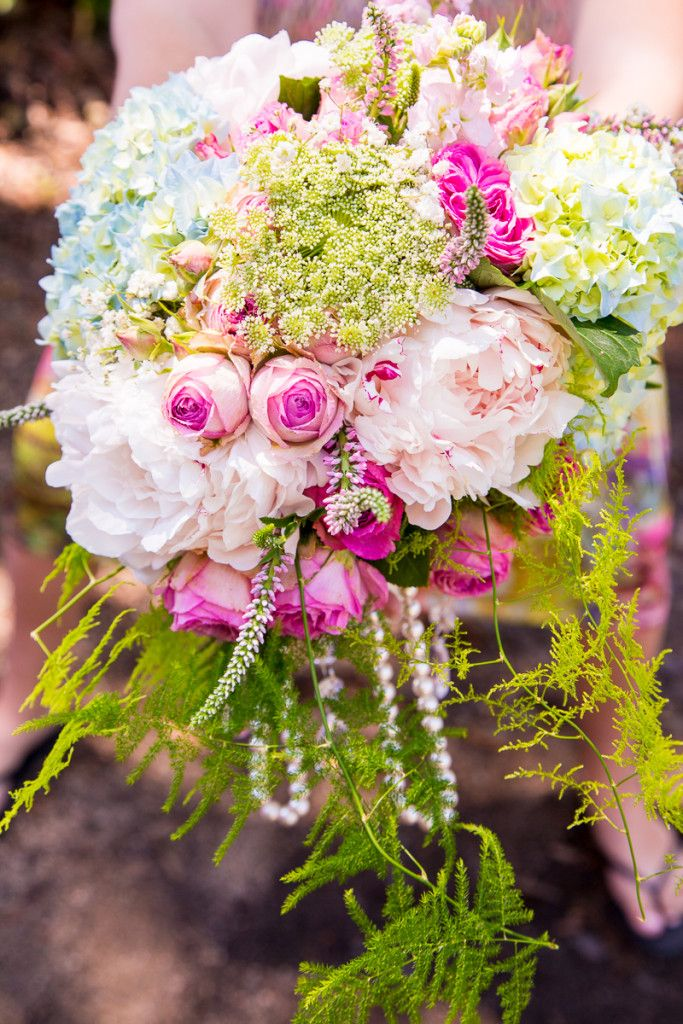 Blooming Brilliant - Mallory and Hugh get married in a beautiful wedding ceremony filled with flowers including peonies, hydrangea, queen annes lace, baby's breath, and fern.