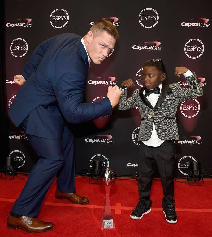 On the ESPYS red carpet, John Cena and perseverance award-winner Jarrius Robertson show off their st... - Kevin Mazur/Getty