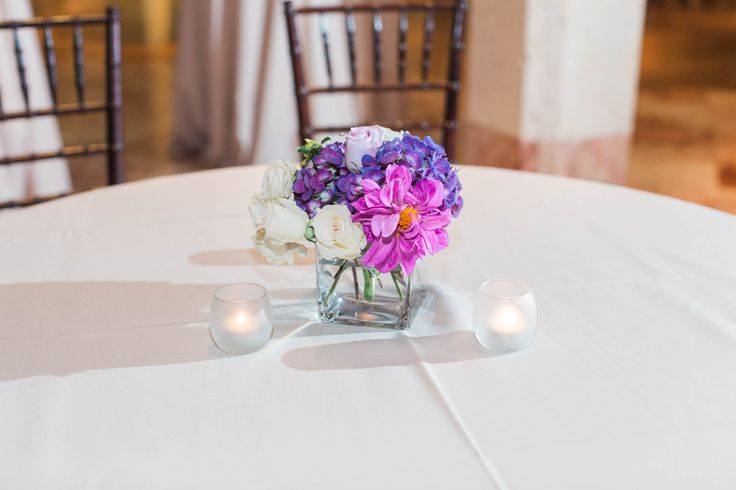 Purple and white wedding reception centerpieces by www.petalsandtwigsrva.com.  Photo Credit: Jillian Michelle Photography