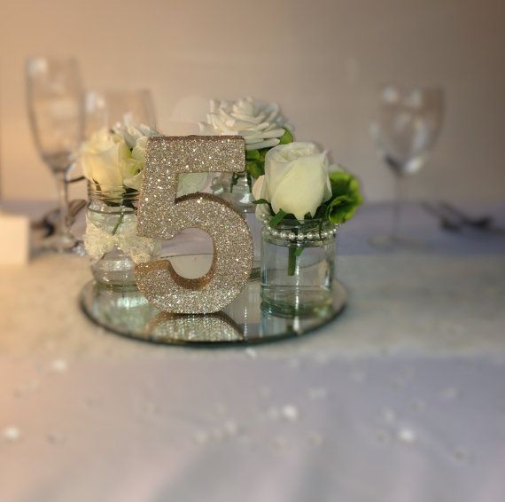 1000 ideas about glitter table numbers on pinterest for Glitter numbers for centerpieces