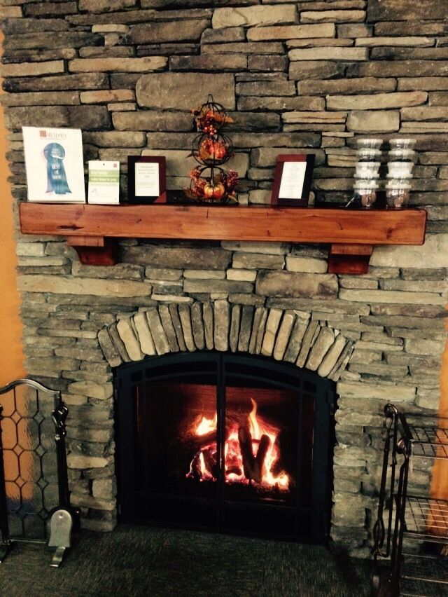Mendota Direct Vent fireplace with stacked stone wall and Pearl Shenandoah Mantel