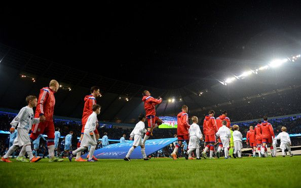 The Bayern Muenchen walk out onto the pitch prior to kickoff during the UEFA Champions League Group E match between Manchester City and FC Bayern Muenchen at the Ethad Stadium on November 25, 2014 in Manchester, United Kingdom.