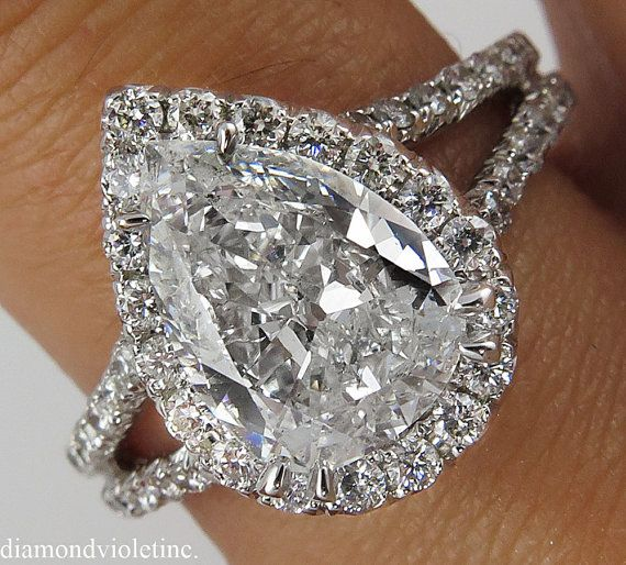 A Beautiful and Elegant EGL USA Certified PEAR Diamond Ring with 1.73ct Center Diamond in F color SI2 clarity (COLORLESS and EYE clear). Super