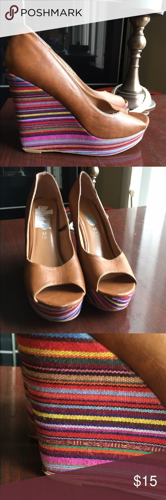 Rue 21 Colorful Stripe Wedge Heel These are a flashy pair of heels! Size 7/8 M, their gently used and colorful as ever. Colors are orange, yellow, purple, Maroon, indigo, light blue, etc. the main section of the show is tan. Rue 21 Shoes Heels