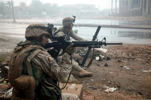 US Marines of the 1st Battalion, 8th Marines battle insurgents in the streets of Fallujah, Iraq, Wednesday Nov. 17 2004. (AP Photo/ LCpl J.A. Chaverri, US Marines)