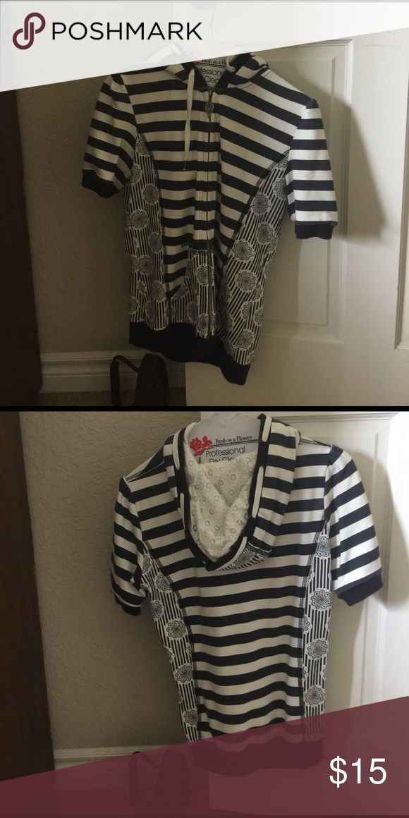 Short sleeve blue and white sweatshirt. Short sleeve blue and white zip up sweat shirt. Price is negotiable and I offer a 10% bundle discount off 2 or more items. Miss Me Other