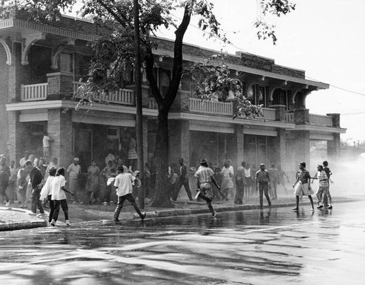 African American children are attacked by dogs and water cannons during a protest against segregation organized by Reverend Dr. Martin Luther King Jr. and Reverend Fred Shuttlesworth in May 1963 in Birmingham, Alabama [Getty Images]