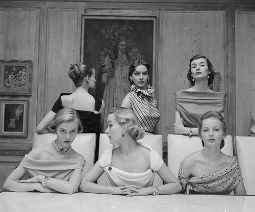 1950 - Photo by Nina Leen < someone needs to make me this one shoulder dress on the right