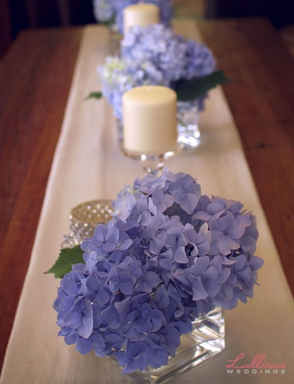 How about hydrangea centerpieces? Wonder if we can find blue/purple ones in October?