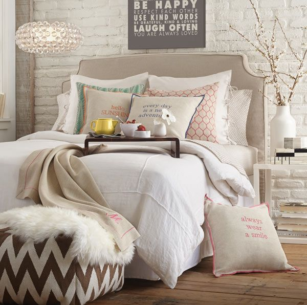 Bedroom idea: taupe and white everything. Mixed textures, chevron pouf. I would kill for a white brick wall too!