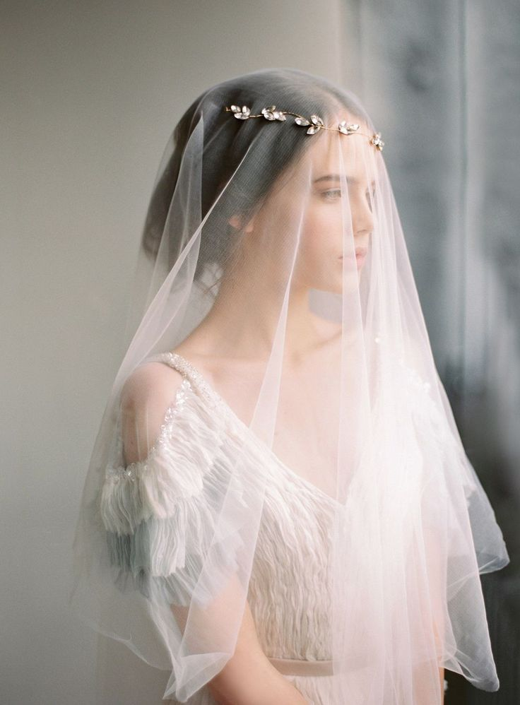 If you are loving a halo and a veil, no need to pick just one!  Layer a delicate headpiece over a single layer veil for an ethereal look | image via Nastia Vesna