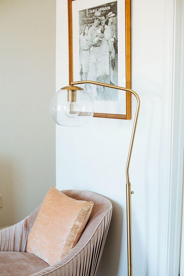 pink velvet chair + gold floor lamp