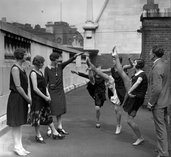 Chorus girls work on their high kicks on the roof of the Gaiety Theatre in London in 1920s London.  Picture: E. Bacon/Topical Press Agency/Getty Images