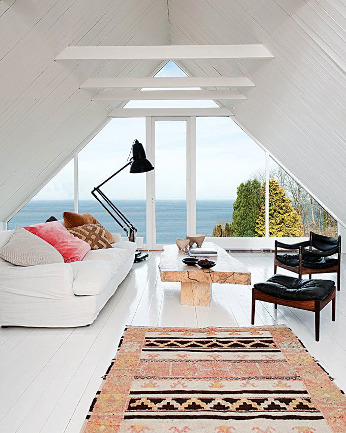 Home #attic renovation with white #painted walls + floors. Loving the view and that oversized #lamp!