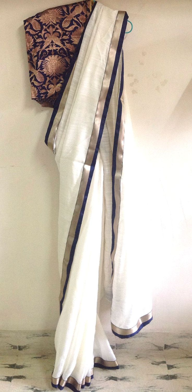 Offwhite semi jute saree with navy and gold border and navy bricade silk blouse by GiaExquisiteIndian on Etsy