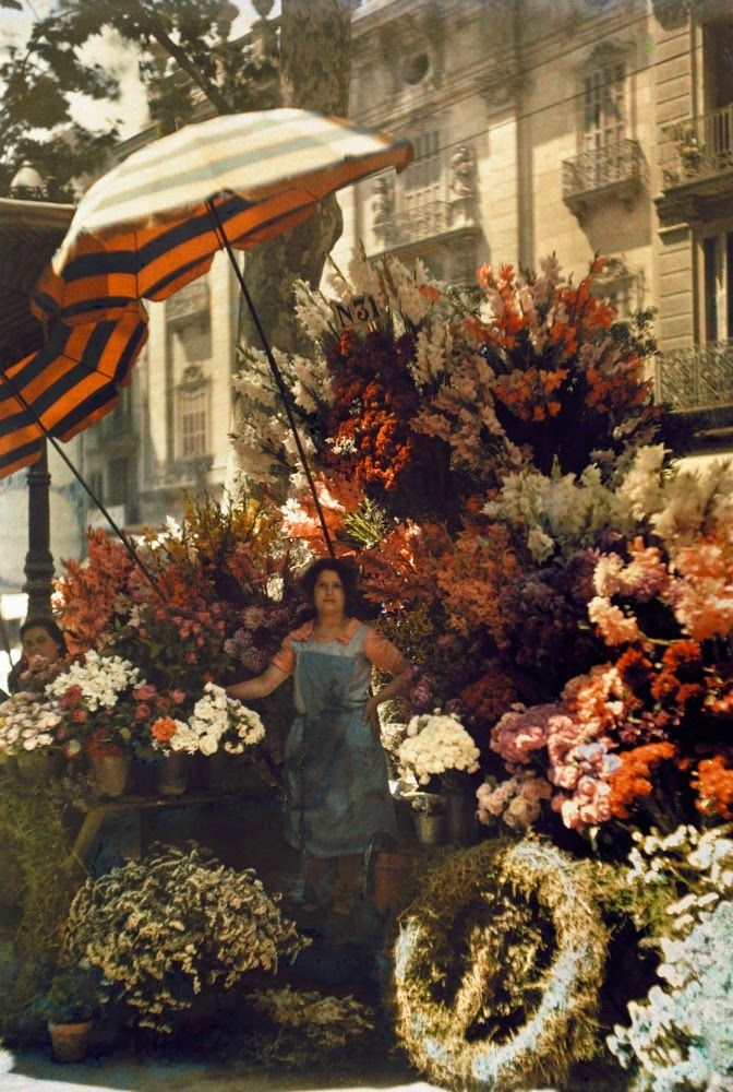 back-then:  A woman stands in front of her flower stand on the Rambla in Barcelona, Spain Jules Gervais Courtellemont 1929