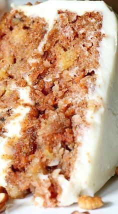 ❊ Out of this World Carrot Cake - A moist and delicious carrot cake chuck full of flavor and texture, topped with the best cream cheese frosting you will ever have.
