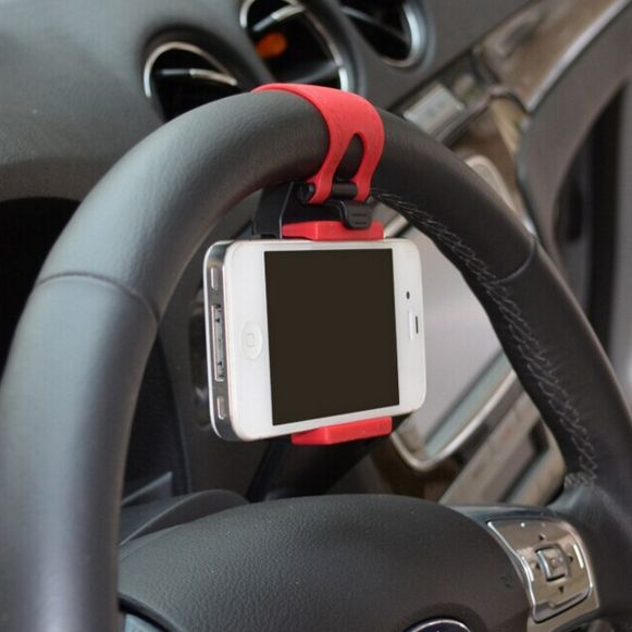 A smartphone, GPS, MP4, iphone universal steering wheel holder is what you need to make your driving safer or give the gift of safety to a loved one. Available now, lowest price around town. Come get it.