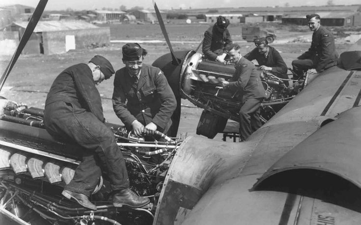Avro Lancaster Mk. I on ground, engine fitters at work on starboard engine at RAF Bottesford