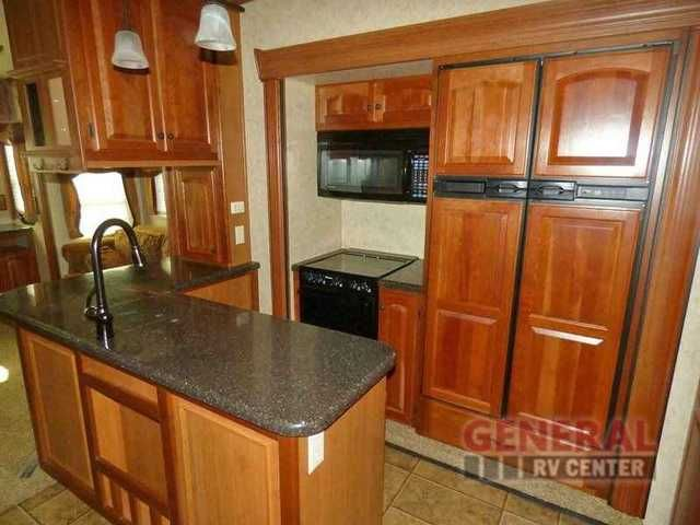 2011 Used Dutchmen Rv Grand Junction 350RE Fifth Wheel in Florida FL.Recreational Vehicle, rv, One of the Nation's Largest Family Owned RV Dealers. Over 3000 new and used RV's in-stock. From 60 of Americas best brand names.