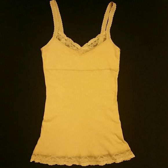 Pale pastel yellow cami ribbed top Pale yellow color with a ribbed material and lace detail at the bottom and top. Great condition with no stains or flaws. Measures 25.5 inches in length. Great summer top. Energie Tops Camisoles