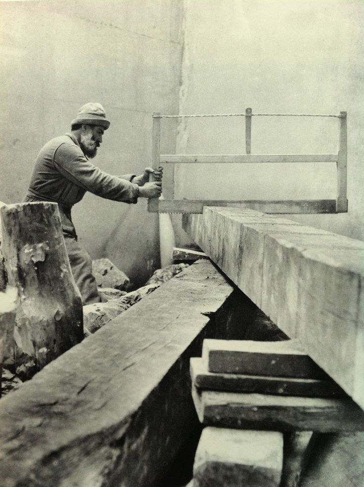 Constantin Brancusi working on the Endless Column in his studio. 1924