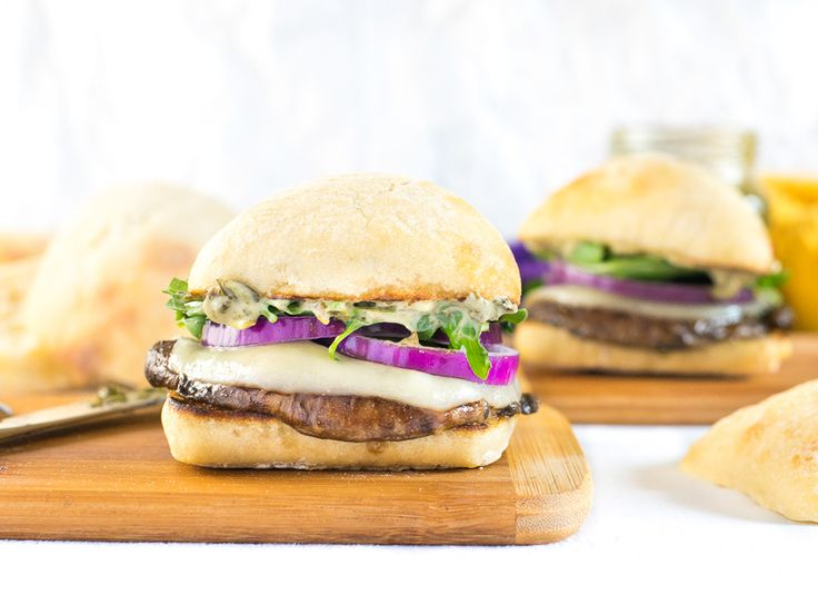 This Portabella Mushroom Burger with Pesto Mayo and Arugula boasts a juicy portabella mushroom which is marinated to enhance its meaty flavor, along with melted provolone cheese and the bold flavors of pesto mayo, red onion and arugula!